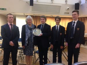The team receiving Schools' Challenge Plate
